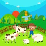 Farmer and farm animals on the farm Stock Photos