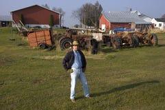 Farmer in Farm Barnyard with Equipment. Farmer posing in farm scene stock photos