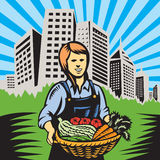 Farmer-female-harvest-building Stock Photo