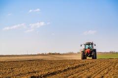 Farmer fertilizing arable land. With nitrogen, phosphorus, potassium fertilizer Royalty Free Stock Photos