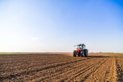 Farmer fertilizing arable land with nitrogen, phosphorus, potassium fertilizer. Agricultural activity Stock Image