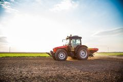 Farmer fertilizing arable land with nitrogen, phosphorus, potassium fertilizer. Agricultural activity Stock Images