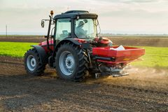 Farmer fertilizing arable land with nitrogen, phosphorus, potassium fertilizer. Agricultural activity Stock Photo