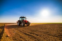 Farmer fertilizing arable land. With nitrogen, phosphorus, potassium fertilizer Royalty Free Stock Image