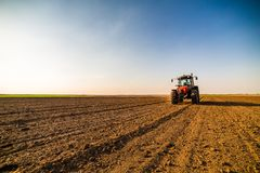 Farmer fertilizing arable land. With nitrogen, phosphorus, potassium fertilizer Stock Photography