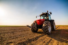 Farmer fertilizing arable land. With nitrogen, phosphorus, potassium fertilizer Royalty Free Stock Photography