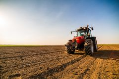 Farmer fertilizing arable land. With nitrogen, phosphorus, potassium fertilizer Royalty Free Stock Photo