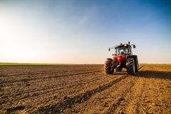 Farmer fertilizing arable land. With nitrogen, phosphorus, potassium fertilizer Royalty Free Stock Photos