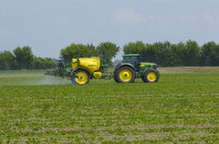 Farmer fertilizing field Stock Photography