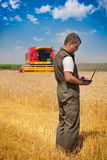 Farmer in a field. Farmer man working at a wheat field Stock Images