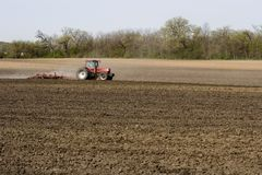 Farmer in Field. Plowing the soil stock photos