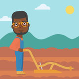 Farmer on the field with plough. Stock Image