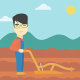 Farmer on the field with plough. Royalty Free Stock Photos
