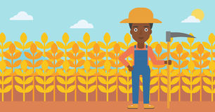 Farmer on the field with scythe. Stock Images
