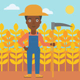 Farmer on the field with scythe. Royalty Free Stock Image