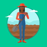 Farmer on the field with shovel. An african-american woman working on a field with a shovel. Female farmer standing with shovel on the background of plowed royalty free illustration