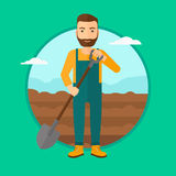 Farmer on the field with shovel. Stock Images
