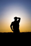Farmer in a field of wheat in the sunset. Happy farmer in a field of wheat in the sunset Royalty Free Stock Image