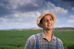 Farmer in the fields. Happy farmer in the fields royalty free stock photos