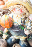 Farmer figurine with pumpkin and nuts. Halloween decoration.ndelier on white background Royalty Free Stock Photos