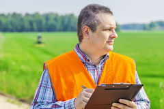 Farmer foreman near the field Stock Photo