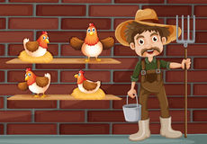 A farmer beside the four hens Stock Photo
