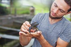 Farmer on frog farm in Bali Royalty Free Stock Photo