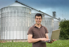 Farmer in front of grain silo Royalty Free Stock Photography
