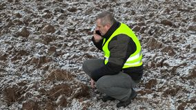 Farmer on frozen field stock footage