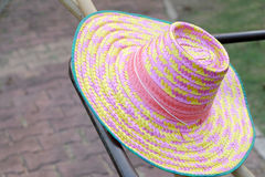 Farmer gardener hat pink color. Background royalty free stock photography