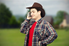 Farmer getting tuned on western music Stock Images