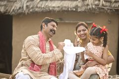 Farmer gifting new dress to little daughter stock photography