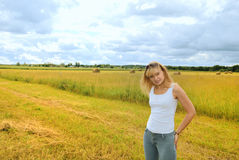 Farmer girl on the field. With wheat Stock Photo