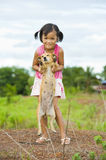 Farmer girl holding a dog Royalty Free Stock Photo