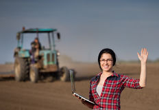 Farmer girl with laptop in the field Stock Image