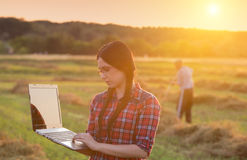 Farmer girl with laptop on ranch Stock Photos