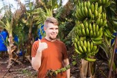 Farmer giving thumbs up on banana plantation royalty free stock photo