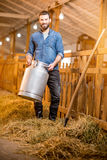 Farmer in the goat barn Royalty Free Stock Image
