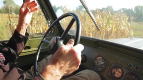 Farmer goes through the field on the old car. stock footage