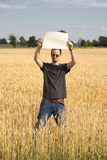 Farmer Guy in Wheatfield Holding Blank Sign stock photos