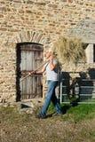 Farmer with hay. For feeding the livestock royalty free stock photos