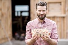 Farmer with hen eggs Royalty Free Stock Photos
