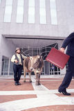 Farmer with his cow in front of a Bank Stock Images