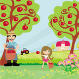 Farmer and his daughter in the orchard Royalty Free Stock Image
