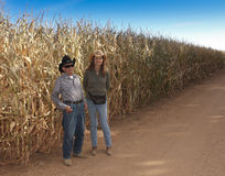 A Farmer and His Daughter Stand by a Cornfield Stock Photo