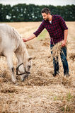 Farmer with his horse. Stock Photo