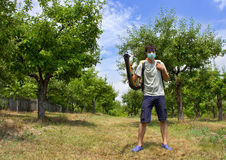Farmer in his orchard with a sprayer. Under blue sky Stock Photo