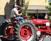 Farmer on his tractor. At the annual National Lentil Festival parade in Pullman, Washington, USA royalty free stock image