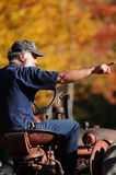 A farmer on his tractor in autumn in New Hampshire Stock Photos