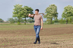 Farmer with hoe Royalty Free Stock Photography